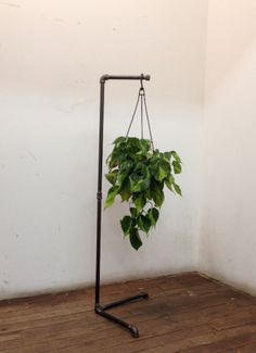 This free standing plant stand is great for hanging plants from. Its about 4ft tall and easy to assemble. Fits great in a corner or out in the open.