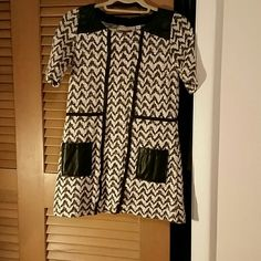 Long top Great with leggings. Faux leather over chevron Anthropologie Tops