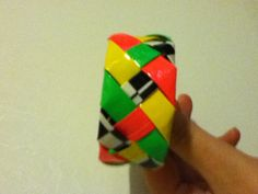 Pink, yellow, neon green, and zebra 4 strand braided bracelet. I made this
