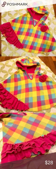 Most Precious Poncho This bright, colorful poncho is super fun!! And it will keep your lil' cutie-patootie nice & warm, too. I cut the tags out because my daughter was always very particular about tags rubbing against her skin. But, I do know the size is a 4/5. The material should be cotton; or at least a cotton blend. It looks and feels just like fleece- it's oh so soft! I don't know the brand but I purchased it from a boutique online. The accent flower and tiered ruffles are simply the…