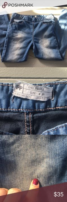 """Free people skinny jean Sooo soft ! 77% cotton - 21% polyester 2% spandex . Feels like jeggings /leggings when on .mid waist . See pics for flaws (pull / clasp near zipper /tag) used gently great condition. Lighter wash. Run small in my opinion . Selling because they are too big on me . 26"""" inseam , perfect for short ladies a cropped pair for ya taller girls ;) Free People Jeans Skinny"""
