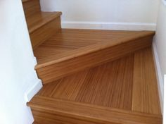 Bamboo flooring on stairs by Capitola Carpets & More. http://santacruzconstructionguild.us/capitola-carpets-and-more/