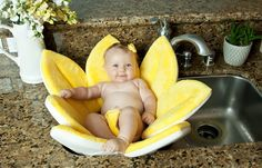Blooming Baby Bath. Its unique design allows the flower to fit inside any sink.  The petals spread out to hug the sides of the sink and provide a safe secure bathing experience for your baby.