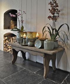 Something like this ( the number of pots, some flowers, etc., some without, etc....on the bench on the porch.