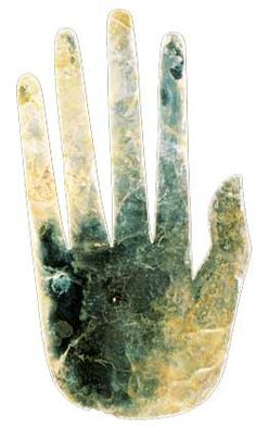 The distinctive effigy hand (shown at left) was recovered from Mound #25 at the Hopewell Mound Group.