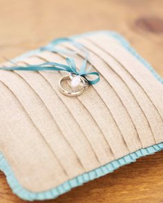 Tricia Roush of House of Nines Designcreated this linen ring pillow with pintucks and pleated ribbon.