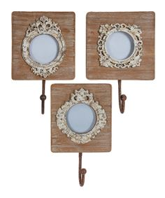 Give each member of the family their own personal spot to park their coats! Place mini portraits in these vintage-inspired picture frames to readily identify scarves and jackets hung on the coordinating hooks.
