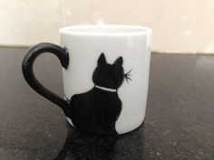 tacita gato negro