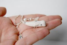 Etsy - Beluga whale necklace  I NEED this.