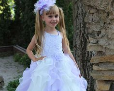 Please read our store policies before placing your order here https://www.etsy.com/ru/shop/Butterflydressua/policy  Gorgeous lace flower girl dress with multilayered skirt, corset with zipper and atlas ribbon.   Item material: upper layer of the skirt- guipure middle layer of the skirt- tulle lower layer of the skirt- taffeta  Item color: ivory & pink  aqua blue & lilac  pink & bright yellow.  Size: 2-3-4-5-6-7-8-9-10 The size chart is the picture of the listing.   Note: - please make the…