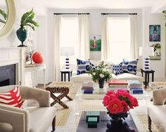 Ikat fabric in blue and the red accessories make this off-white room crisp.