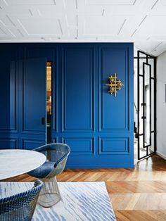 """House tour: a historic penthouse receives an entirely custom-made renovation: The old layout was """"rather poky and had a narrow entrance, typical of Amsterdam"""", so Geerlings went about creating a cobalt-blue cube as the centrepiece of the ground floor, which organised the space more effectively than any passageway."""