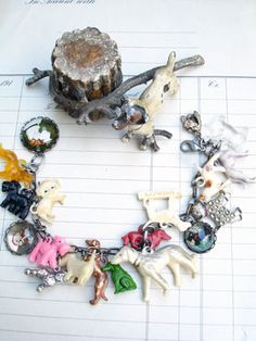 Vintage Dogs Charm Bracelet with Puffy Dog  This one has 19 different, vintage dog charms including celluloid, metal, glass cabochons. All the charms are vintage and special and many breeds are represented including: Airdales, mutts, Poodles, Dachshunds, Spaniels and more! ...