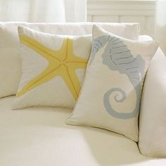 Cute pillows! For my room theme colors I would want coral, blue, and sea foam
