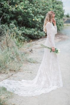 SELENA, for the unique and untamed bride. Beautiful sheer long lace sleeves, an open v-shaped back and long one metre train skirt. This dress will have all the bride's guests in awe. See more here: https://shop.goddessbynature.com/products/selena-french-lace