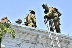 Troy firefighters put out a fire at 673 Avenue in Lansingburgh. (Mike McMahon / The Record) Injury Report, Second Story, Firefighters, Troy, Firemen, Fire Fighters