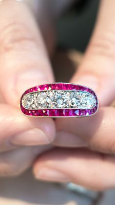 Antique Edwardian ring made in platinum featuring five old European cut diamonds accented with French cut rubies. Circa 1915.