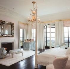 There's something very sort of princess-y about this room, but in an adult way. I love all the windows!