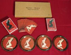 Vintage 1950s or 60s? Marilyn Monroe Coasters, Bridge and Canasta Card Gift Set. All pieces have Marilyns iconic first nude pin up pose. I believe the second deck that is unopened has a second pose, but I am not 100%. One box of cards still has cellophane sealing it. Interior of box has wear in the area that holds the coasters. The coasters are metal and in fantastic condition, look nearly unused. Outer box is in good condition also.