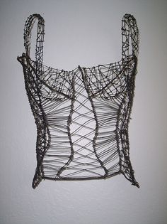 'corset' by unknown artist. Photographed by laundrygirl via flickr