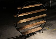 Reclaimed Old Growth Barn Wood & Steel Circular Book Shelf. $2,365.00, via Etsy.