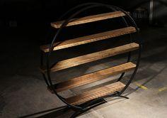 Reclaimed Old Growth Barn Wood & Steel Circular Book Shelf. $2,365.00, via Etsy.