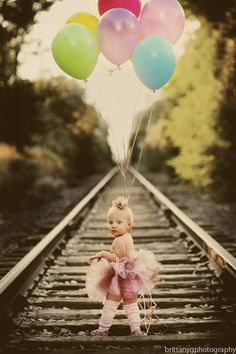 Just when I think to myself - all these photos on rail road tracks are so cheesy - then I see this. Imagine a baby boy, love the balloons - so cute. Then, the very next pic on Pinterest was a senior year/letter jacket pic on RR tracks. Oh the possibilities....if its a boy ; )