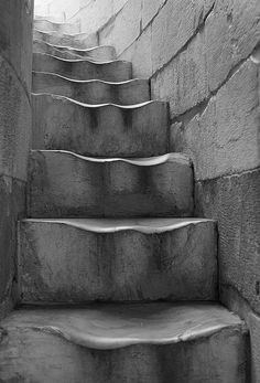 Leaning Tower of Pisa: steps are so worn from centuries of visitors.