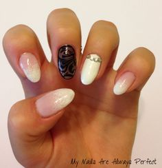 Baby pink and white ombre with black accent nail.