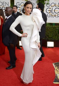 Paula Patton is apparently borrowing style tips from Lady Gaga. Is it just us or does the left side of her dress look ready to attack?