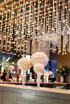 Romantic Suspended White Roses with White Carnation Pomanders Wedding Reception Decor riverpark New York Wedding Floral Decor by Bride & Blossom Photo by Trent Bailey