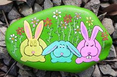 These silly rabbits have a story to tell! Youll never find another one like this. This one-of-a-kind design is hand-painted by me on river rock,