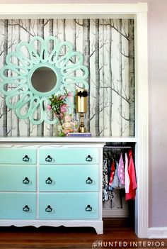 take doors off closet in small bedroom, put dresser in closet with table top all the way across, hanging bar space and fabulous wallpaper