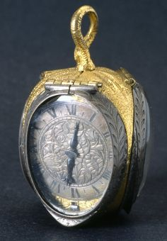 GILT-BRASS AND SILVER CASED VERGE WATCH IN THE FORM OF A TULIP BUD. 1640-1650 Geneva