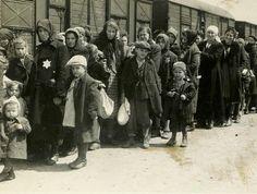 Woman and children on the Birkenau arrival 'ramp'.The Auschwitz Album.
