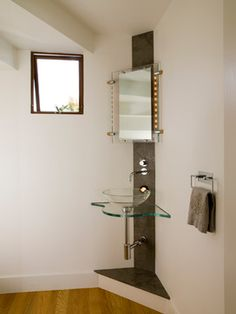 This shows that you can have a handsome sink even if shoved in a courner...which might  be necessary in a really tine attic space like the upstairs bathroom at the cambridge house.