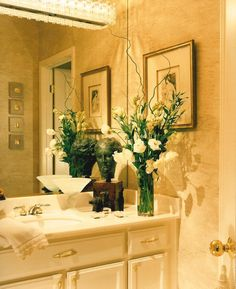SUZANNE MYERS ELITE INTERIOR DESIGN: Sophisticated limestone and crystal powder room.