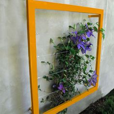 Just paint a frame and attach it to the wall or fence... voila!