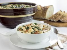 Turkey White Bean + Kale Soup Recipe | HGTV >> http://www.hgtv.com/design/make-and-celebrate/entertaining/turkey-white-bean-kale-soup?soc=pinterest