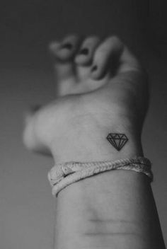 Small diamond tattoo: on right hip, behind ear, or center of wrist