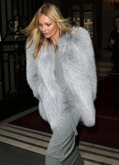 Kate Moss in a gray fur.