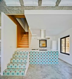 The way the stairway decorated makes the kitchen look more spacious than it actually is. However, the fact you can actually put your feet on the countertop? Would not be the best idea for homes with kids or dogs. --- House for three Sisters / Blancafort-Reus Arquitectura