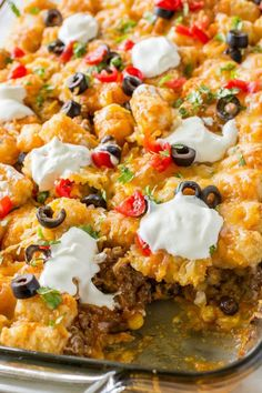 This Tater Taco Casserole is a Mexican mixture of taco meat, beans, corn, and cheese topped with tater tots and enchilada sauce. The family will love it. This Tater Taco Casserole is a dish that the Sauce Enchilada, Tater Tot Recipes, Cooking Recipes, Healthy Recipes, Delicious Recipes, Easy Mexican Food Recipes, Mexican Cooking, Spinach Recipes, Top Recipes