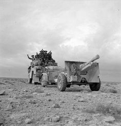 1 1941 Harassing the Italians with gunfire. A 25-pdr field gun and 'Quad' artillery tractor, 22 December 1941.