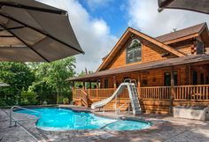 This beautiful pool located in Stanley, VA offers all the fun you can imagine. Log Cabin Home Kits, Log Cabin Homes, Log Cabins, Rocking Chairs, Lounge Chairs, Log Homes Exterior, Porch Area, Modern Pools, Beautiful Pools