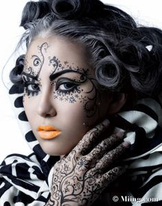 Intricate henna-style make-up with crystal accents.