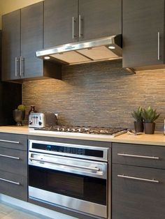 Contemporary Kitchen with limestone tile floors, Flush, Limestone counters, Ceramic Tile, European Cabinets, One-wall