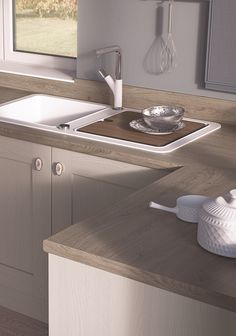 EGGER Kitchen. Worktop: H1399 ST10 Truffle RIverside Oak Featuring knots and imperfections, Truffle Riverside Oak is a rustic design that combines well with light shades from white to grey due to its colour arrangement as well as light stone flooring designs. Its ST10 surface texture delivers a highly authentic finish. Doors: U702 ST27 Cashmere