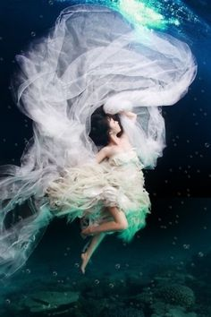 Underwater wedding pictures is a new way to go. I like it.