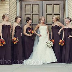 The seven bridesmaids wore strapless brown evening gowns with little trains on the back.  #PerfectWedding